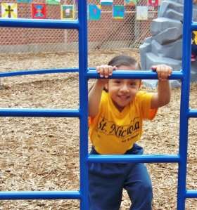Happy student enjoying the renewed playground.