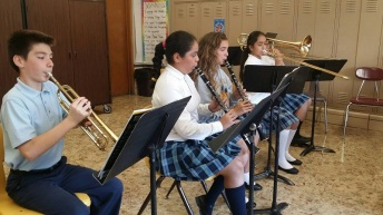 students rehearsing their music at St. Nicholas of Tolentine